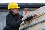 Laurie Legrand building a roof